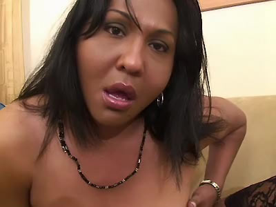 Chubby shemale shows off her ass cock and tits