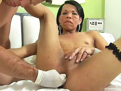 A dirty dude sticks his hand up tgirl's slutty ass